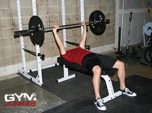 A person performing a standard barbell bench press