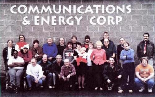 Staff photo at the outside of Communications and Energy Corporation, 1996