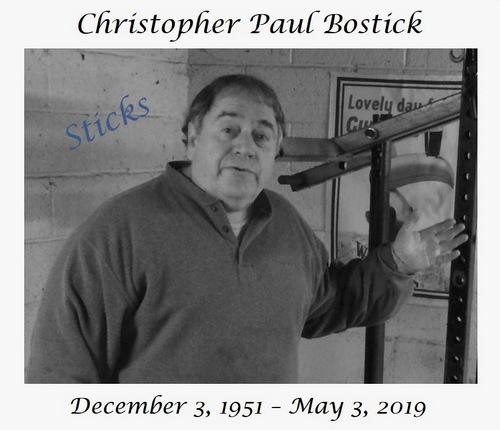 Chris Paul Bostick in his garage gym and standing in front of his leverage muscle-building machine.  Above the photo reads Christopher Paul Bostick. Below the photo reads December 3, 1951 - May 3, 2019.