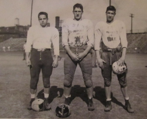 Clarence in football uniform posing with two of his football teammates