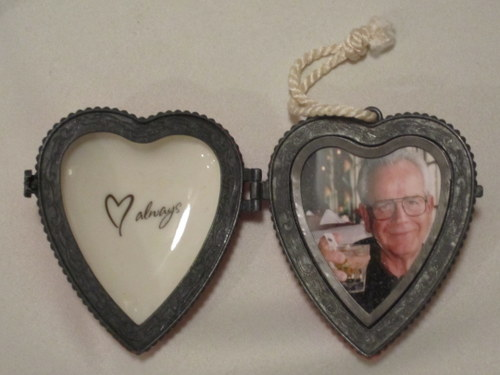 "Heart locket necklace with the word ""always"" engraved on one side and a picture of Clarence Harrison on the other side"
