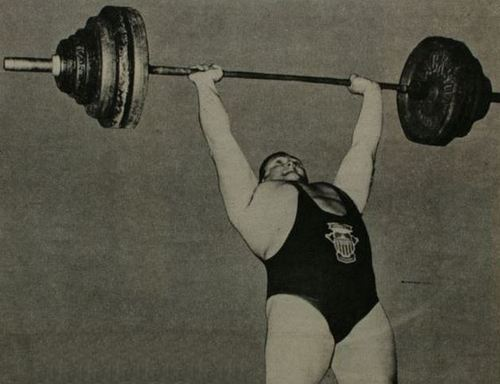Doug Hepburn pressing a 410-barbell overhead with perfect form.