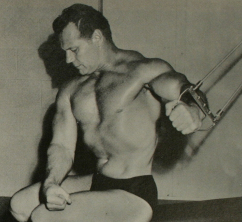 John Grimek demonstrating a cable exercise for building the chest muscles.