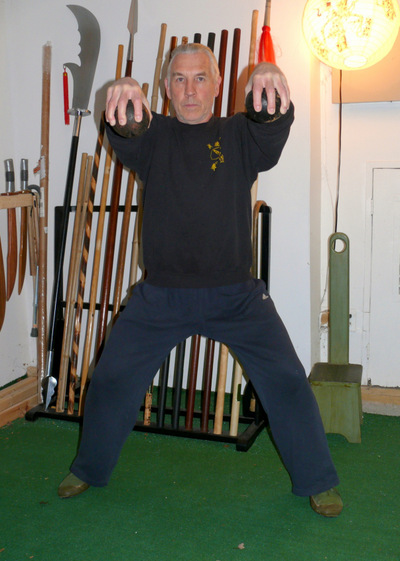 Peter yates demonstrating the Brush On exercise for grip building