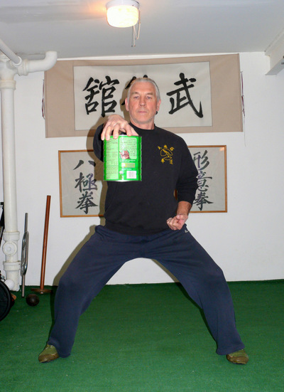 Peter Yates demonsrating the Tip Hold exercise, using a small container, for grip building