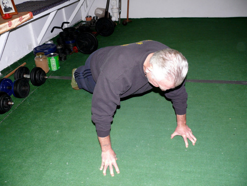 Peter yates demonstrating the Finger Tip Pushup exercise for grip building