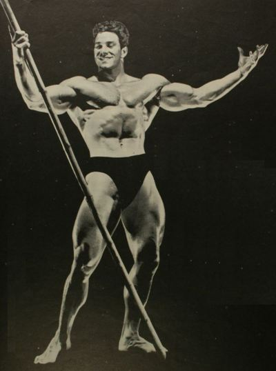 Reg Park looking muscular and powerful