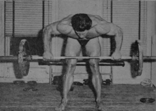 Reg Park performing the Bent-Forward Row with a barbell.