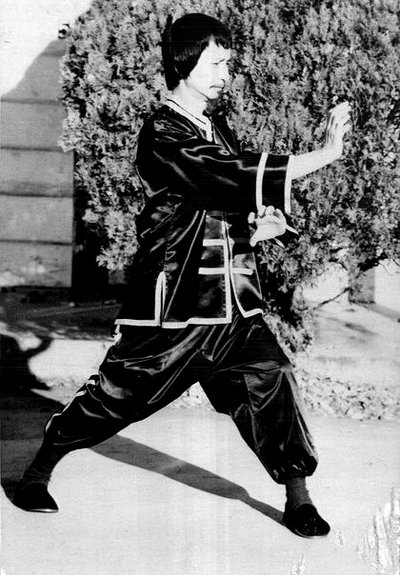 Sifu Share K. Lew in his sixties demonstrating a Kung Fu posture