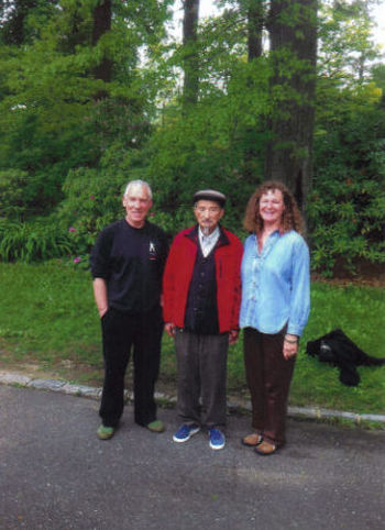 Peter Yates standing with Sifu Share K. Lew and his wife Juanita.