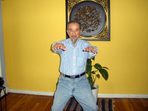 Sifu Share K. Lew in a horse-riding stance.
