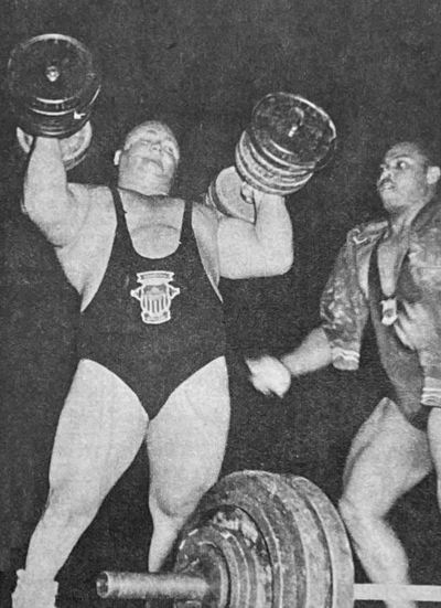 Doug Hepburn pressing a pair of 157-pound dumbbells.