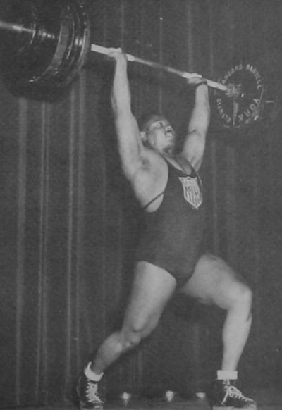 John Davis completing a 402-pound clean and jerk.