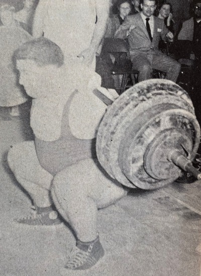 Paul Anderson performing a deep knee bend with a 660-pound barbell across his shoulders.