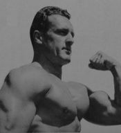 Clancy Ross, the 1945 AAU Mr. America, displaying his massive chest and arm