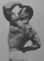 John Grimek showing his muscular back and mighty arm